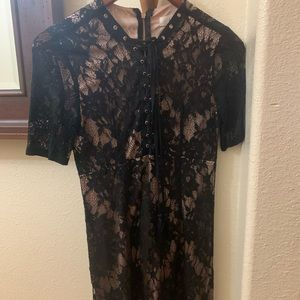 Black lace mini dress with satin nude under layer